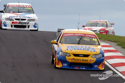 Dean Canto (66) leads Garth Tander (34) while Mark Skaife (1) looms in the background