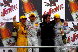 The podium: race winner Bernd Schneider, Marcel Fassler and Laurent Aiello