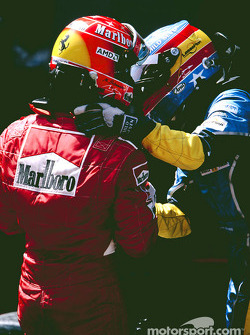 Race winner Michael Schumacher with Fernando Alonso