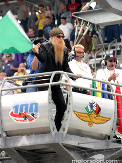 Billy Gibbons of ZZ Top throws the green flag