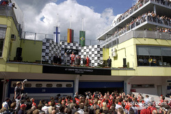 The podium: race winner Michael Schumacher with Kimi Raikkonen and Rubens Barrichello