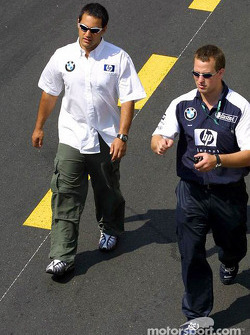Juan Pablo Montoya walks to the drivers parade