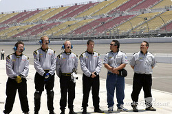 The crew lines up for the national anthem.