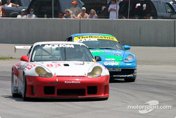 #83 Rennwerks Porsche GT3 RS gets around the slower #41 Planet Earth Motorsports Porsche 911.