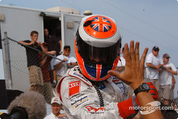 Race winner Johnny Herbert celebrates