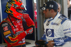 Jeff Gordon, left, getting to grips with the steering travel of an F1 car