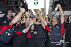 Minardi team members celebrate two fastest times