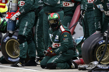 Jaguar team members wait for pitstop
