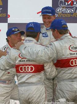 Overall and LMP900 podium: Audi drivers Frank Biela, Marco Werner, J.J. Lehto and Johnny Herbert celebrates