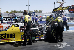 The crew of John Smith's Prestone Dragster do last minute checks