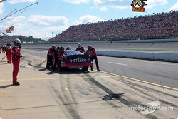 Jason Leffler breaks an axle leaving his pit stall