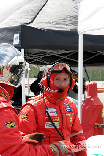 #29 JMB Racing USA/Team Ferrari crew after their car completes a pit stop