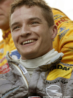 Timo Scheider celebrates pole position