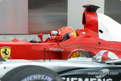 Race winner Michael Schumacher in parc fermé