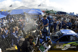 Winners Petter Solberg and Phil Mills celebrate victory