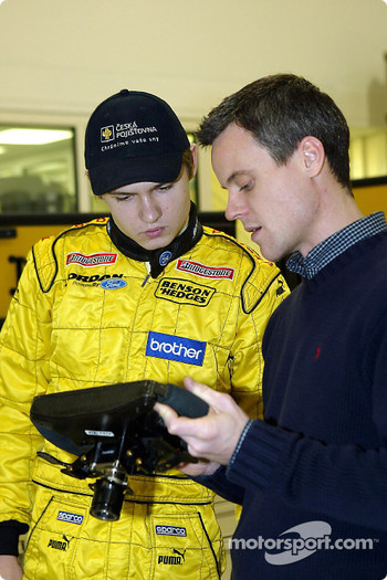 Jaroslav Janis checks the steering wheel of the Jordan EJ13