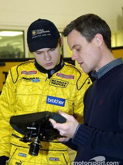 Jaroslav Janis checks the steering wheel of the Jordan EJ13