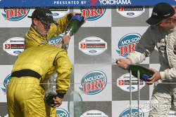 Podium: champagne for A.J. Allmendinger, Ryan Dalziel and Aaron Justus