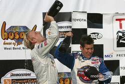 Podium: champagne for Ryan Dalziel and Kyle Krisiloff