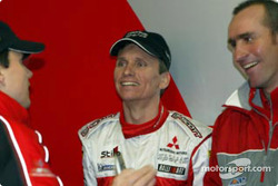 Hervé Panizzi and Gilles Panizzi chat with Dakar winner Stéphane Peterhansel