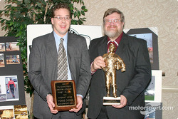 Motorsport.com's Tom Chemris and Greg Gage display their awards