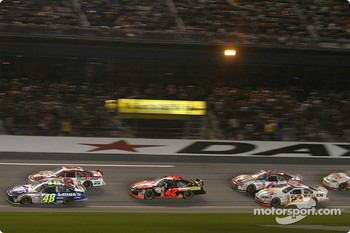 Jimmie Johnson and Dale Earnhardt Jr. lead a group of cars