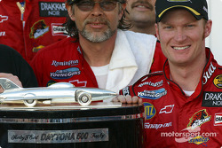 Dale Earnhardt Jr. poses with the Harley F. Earl Daytona 500 winner's trophy