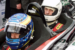 Zsolt Baumgartner takes a passenger in the Minardi twin-seater in the streets of Budapest