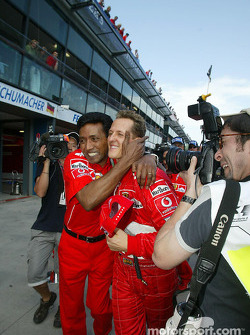 Michael Schumacher celebrates pole position