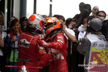 Michael Schumacher and Rubens Barrichello celebrate Ferrari one-two punch