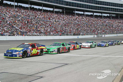 Greg Biffle leads a large pack in for pit stops