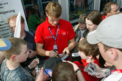 Martin Tomczyk signs autographs