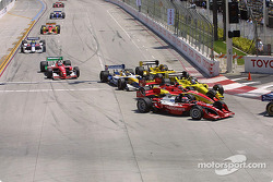 Jimmy Vasser, Justin Wilson and A.J. Allmendinger battle in the first corner