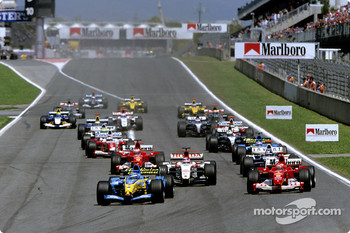 Start: Jarno Trulli takes the lead ahead of Michael Schumacher and Takuma Sato