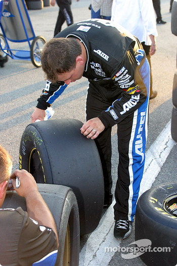 Ryan Newman inspects his tires after happy hour
