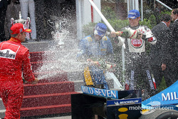 Podium: champagne for Jarno Trulli, Jenson Button and Rubens Barrichello