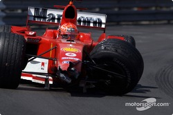 Michael Schumacher drives his wrecked car back to the pit