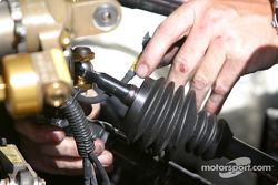 Champion Racing crew work on the damaged suspension of the #2 Audi R8