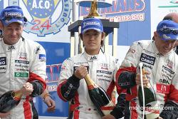 LM P1 podium: champagne for Tom Kristensen, Seiji Ara and Rinaldo Capello