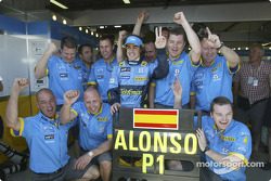 Pole winner Fernando Alonso celebrates with his team