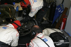 Champion Racing crew work on the damaged #2 Audi R8
