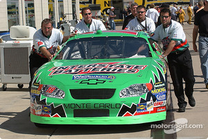 Team Interstate Batteries pushes the car into tech inspection