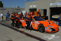 Robby Gordon crew push the car