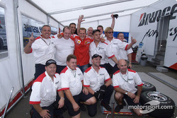 Michael Schumacher celebrates 7th World Championship with Bridgestone team members