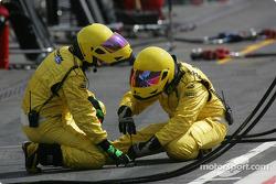 Jordan team members prepare pit area