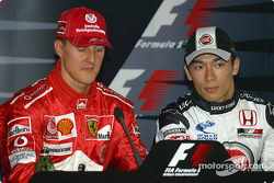 Press conference: pole winner Michael Schumacher with Takuma Sato