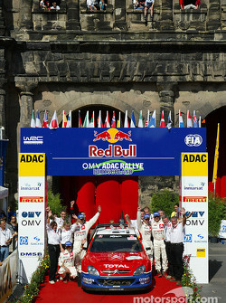 Podium: winners Sébastien Loeb and Daniel Elena celebrate with Carlos Sainz and Marc Marti