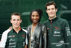 Christian Klien and Mark Webber pose with decathlete Denise Lewis