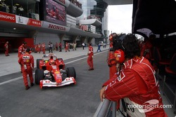 Michael Schumacher goes to the starting grid
