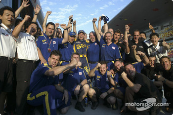 Jenson Button and BAR-Honda team members celebrate second place finish